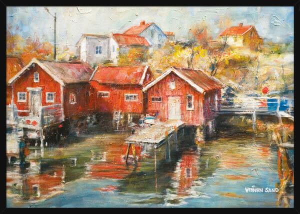 Red cabins on the shore of a fishing village, a landscape painted by Vebjorn Sand. Art print in a black frame.